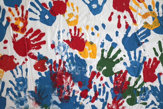 Colorful childish hand prints on white background. — Stock Photo