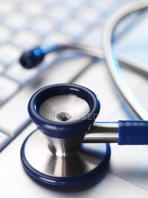 Stethoscope on laptop keyboard — Stock Photo