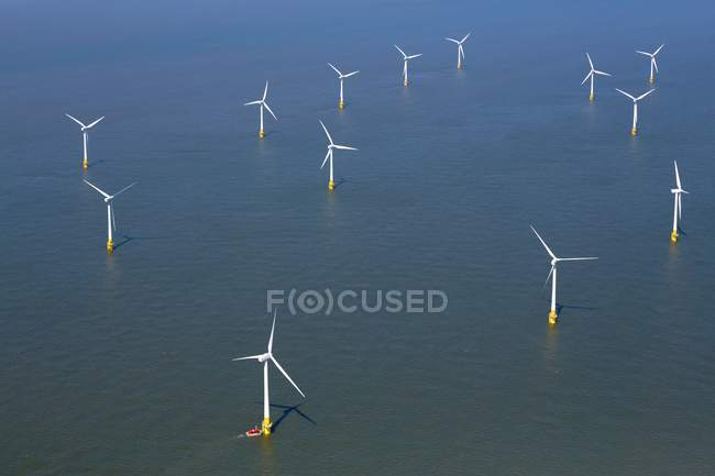 Wind turbines of windfarm in North Sea, England. — Stock Photo