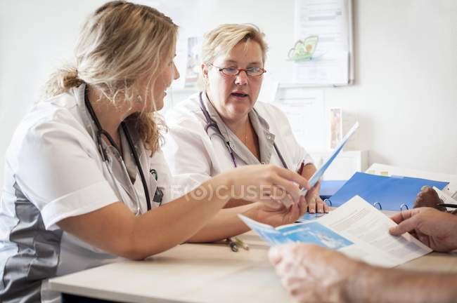 Hospital nurses having meeting with documentation. — Stock Photo