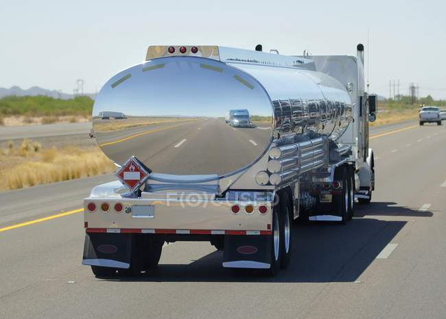 Mirror reflection of tanker cistern on road. — Stock Photo
