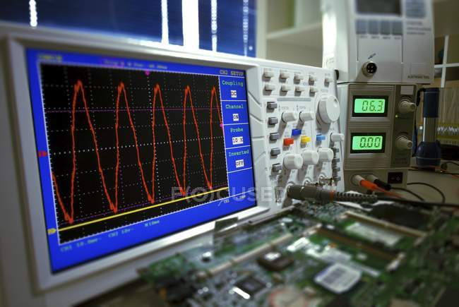 Close-up of oscilloscope screen showing voltage signals. — Stock Photo
