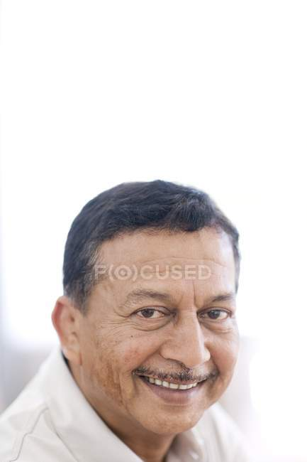 Portrait of smiling mature man. — Stock Photo