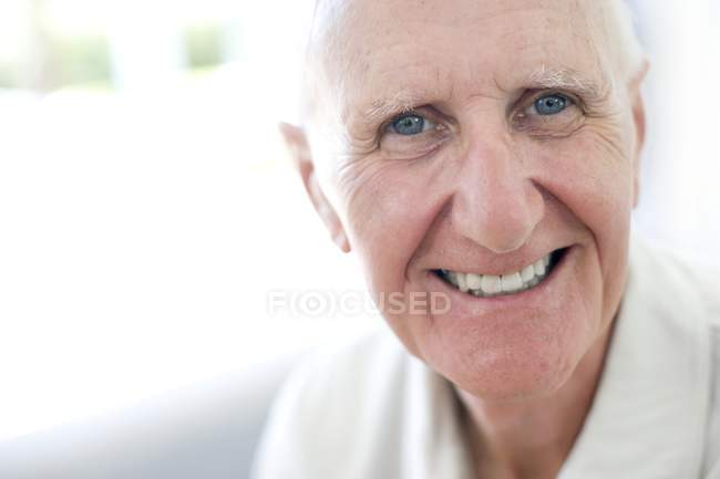 Portrait of happy senior man looking in camera — Stock Photo