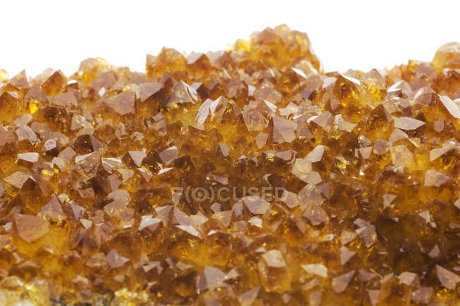 Close-up of citrine crystals on white background. — Stock Photo