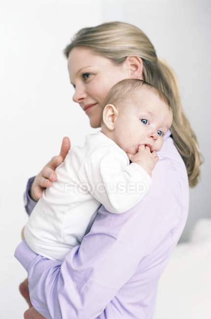 Mother holding baby daughter. — Stock Photo