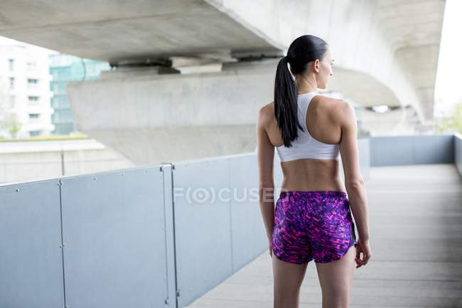 Young woman in crop top and shorts — Stock Photo
