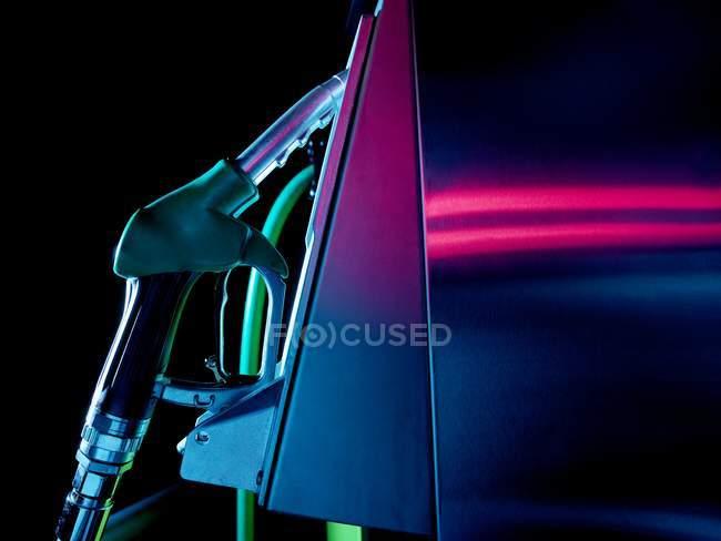 Close-up view of petrol pump illuminated at night. — Stock Photo