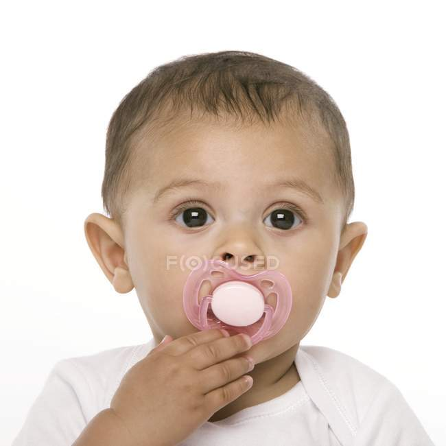 Portrait of baby girl with pink pacifier. — Stock Photo
