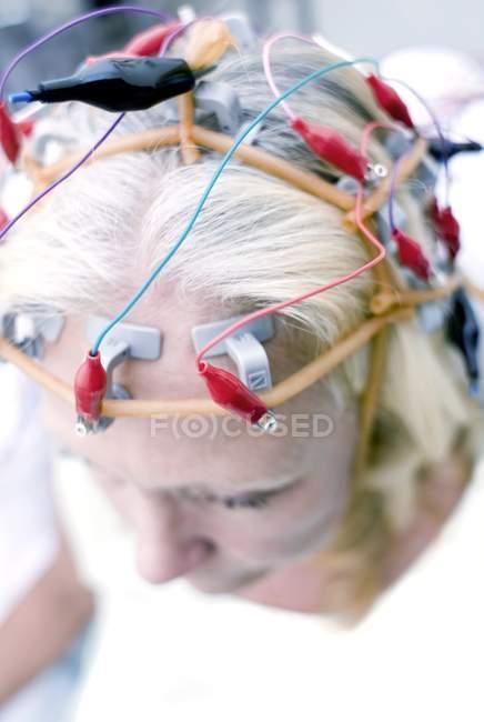 Mature blonde woman undergoing electroencephalography monitoring. — Stock Photo