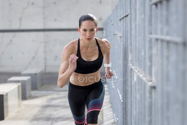 Woman running towards camera — Stock Photo