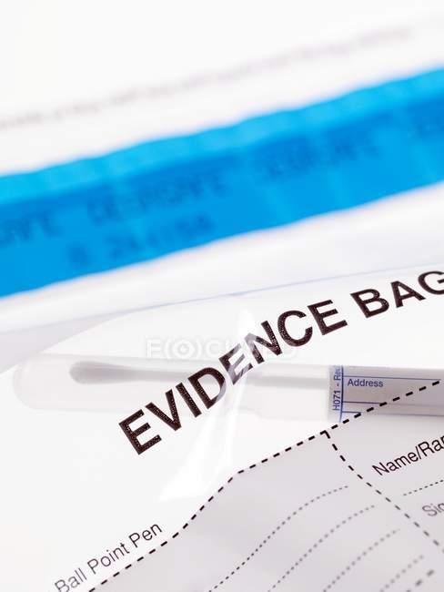 Swab sample from inside forensic evidence bag. — Stock Photo