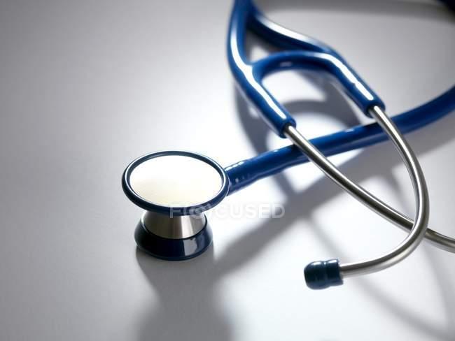 Close-up of blue stethoscope on white background. — Stock Photo