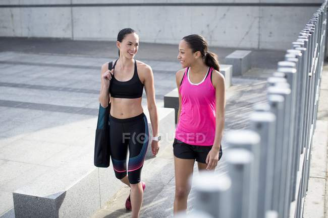 Women in sports clothing walking outdoors — Stock Photo