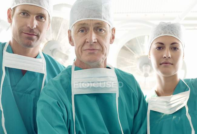 Surgical team posing in operating theater. — Stock Photo