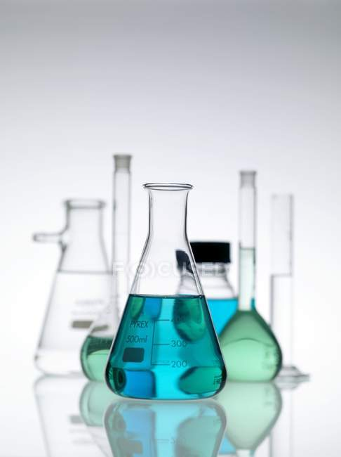 Laboratory glassware standing on table. — Stock Photo