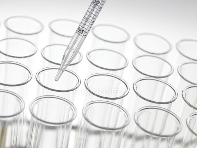 Graduated pipette and test tubes — Stock Photo