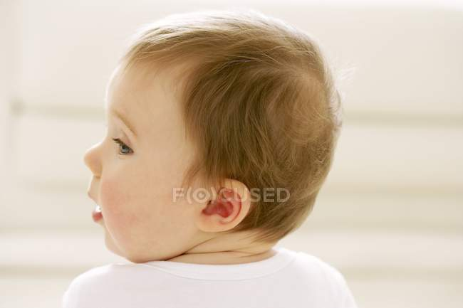 Portrait of baby boy turning head. — Stock Photo