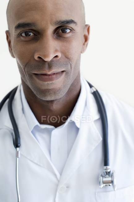 Portrait of cheerful male doctor with stethoscope. — Stock Photo