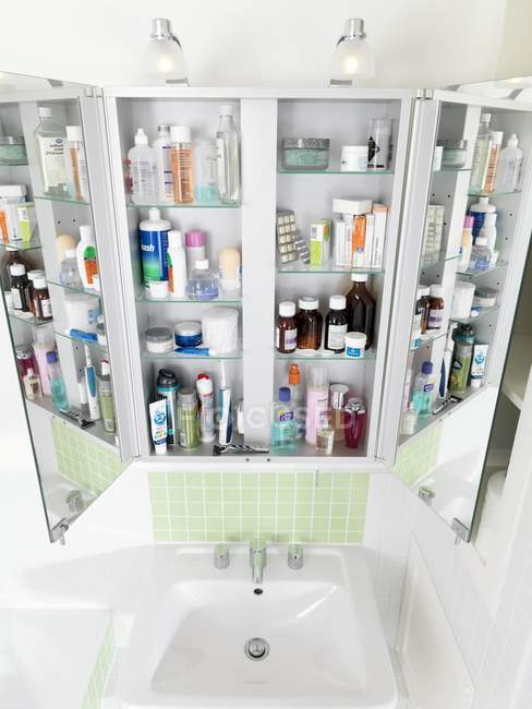 Bathroom cabinet with various drugs and medicine. — Stock Photo