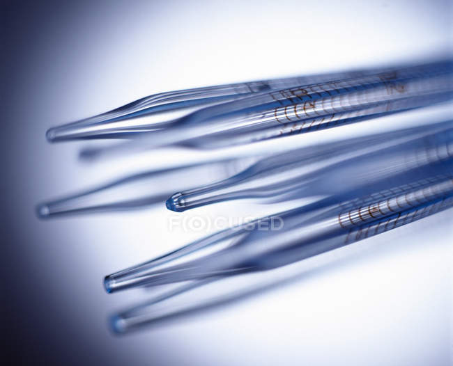 Standardized volume pipettes with bulbs, close-up. — Stock Photo