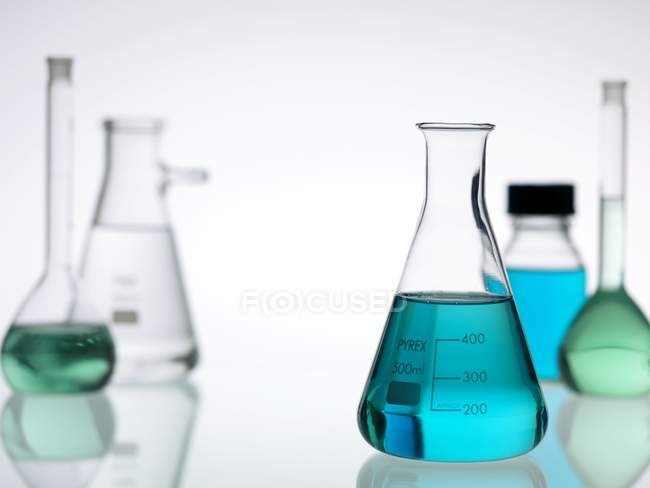 Laboratory glassware standing on table. — Stock Photo