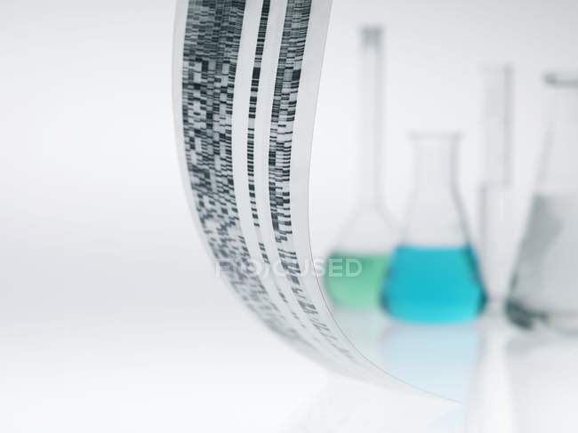 Close-up of DNA autoradiogram with flasks in background. — Stock Photo