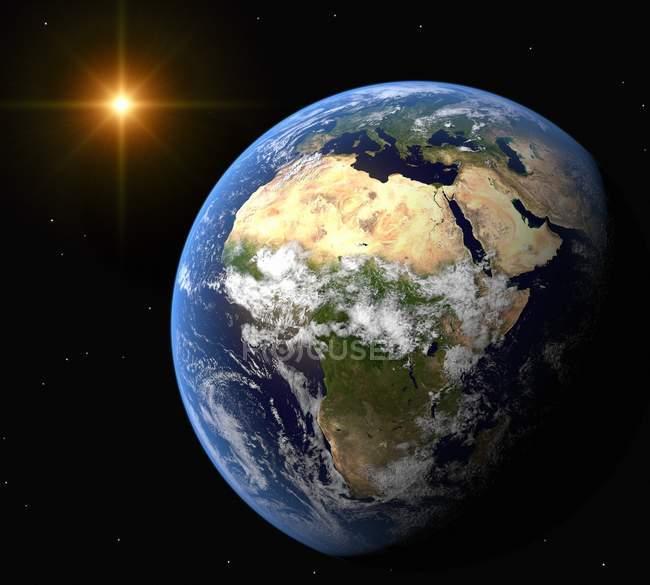 La Tierra y el Sol - foto de stock