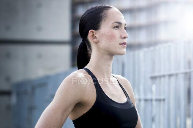 Young woman in crop top looking away — Stock Photo