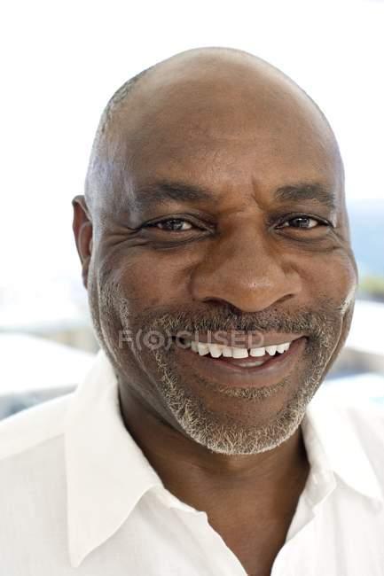 Portrait of cheerful mature man. — Stock Photo
