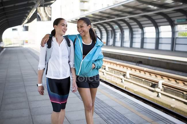 Women in sports clothing on railway platform — Stock Photo