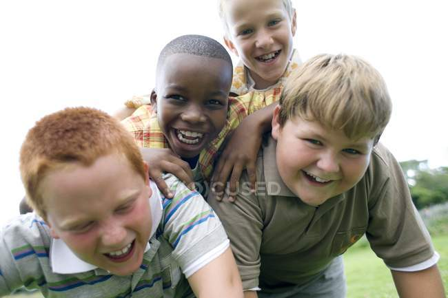 Portrait of group of elementary age boys outdoors. — Stock Photo