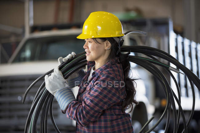 Power engineer with power cable — Stock Photo