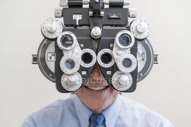 Man having eye test with special equipment. — Stock Photo