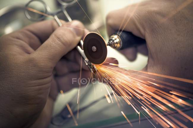Close-up of hands repairing dental tools. — Stock Photo