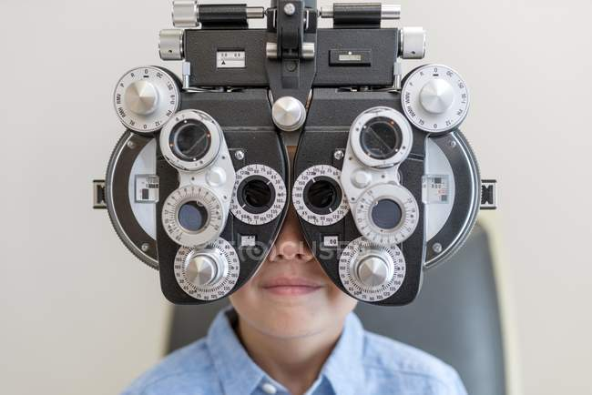 Boy having eye test with special equipment. — Stock Photo