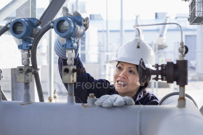 Power engineer checking pressure transducers — Stock Photo