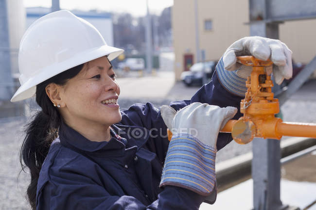 Power engineer checking valve — Stock Photo
