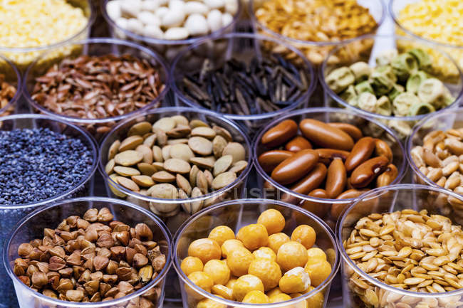 Various legumes in containers. — Stock Photo