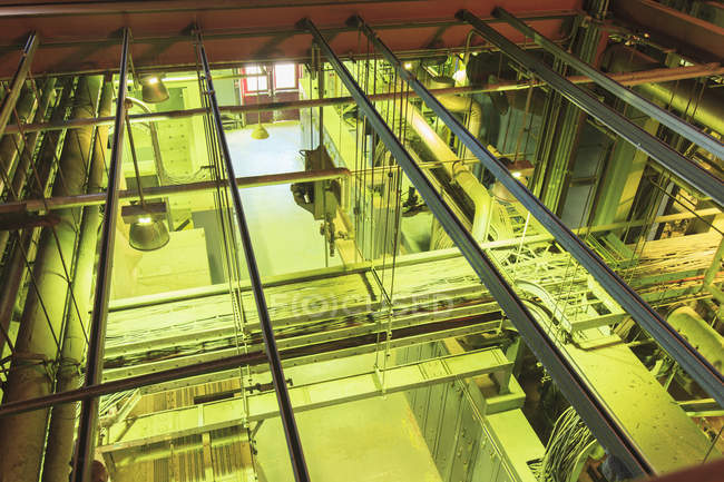 High angle view of control panels and cable troughs at electric power plant. — Stock Photo