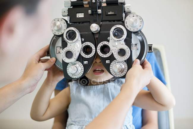 Girl having eye test in clinic with doctor. — Stock Photo