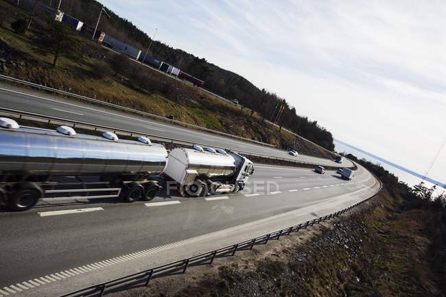 Fuel tanker driving on highway, elevated view. — Stock Photo