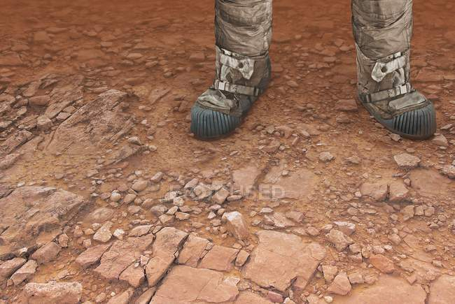 Digital artwork of pair of legs on surface of red planet Mars. — Stock Photo