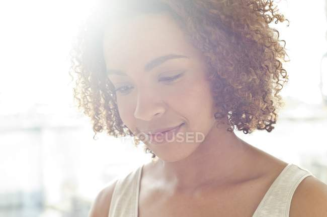 Woman smiling and looking down — Stock Photo