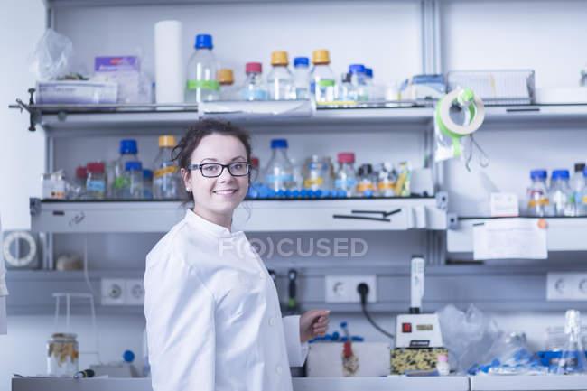 Female scientist posing in laboratory. — Stock Photo