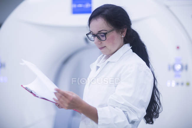 Hospital radiologist checking notes. — Stock Photo
