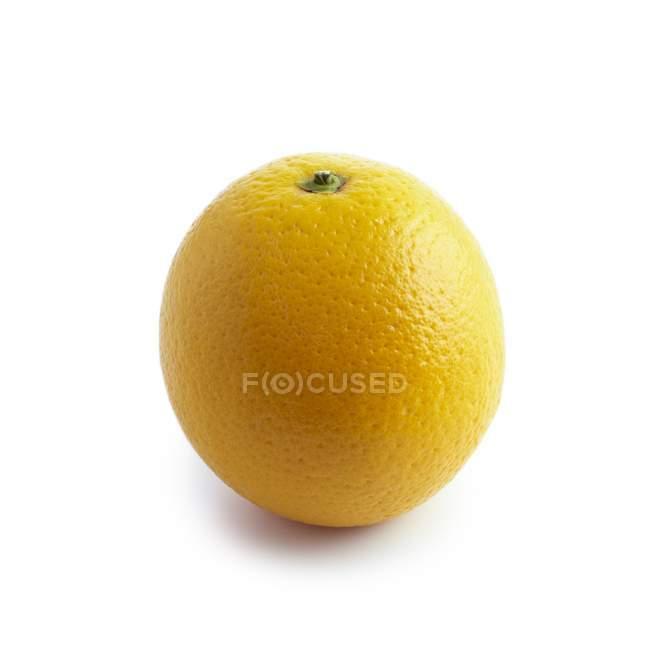 Close-up view of orange fruit on white background. — Stock Photo