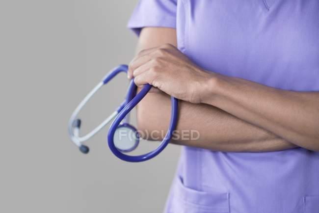 Female doctor holding stethoscope. — Stock Photo