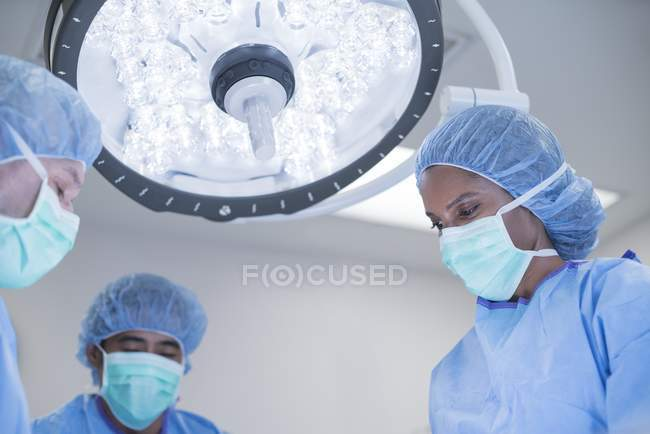 Doctors during operation in hospital. — Stock Photo