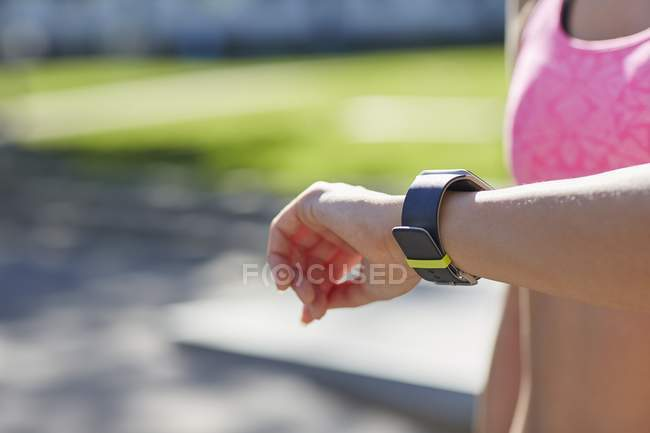 Woman checking time on sports smartwatch. — Stock Photo